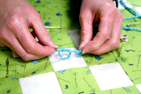 How to tie a quilt tutorial connectingthreads repeat this tying process until the entire quilt is secured remove the basting pins and give the quilt a few test tugs to see if it feels secure ccuart Image collections