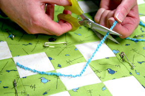 How to tie a quilt tutorial connectingthreads ccuart Image collections